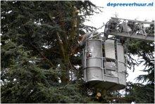 Boom rooien met telescoopkraan