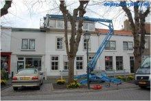 Knikarm aanhangerhoogwerker reparatie dak